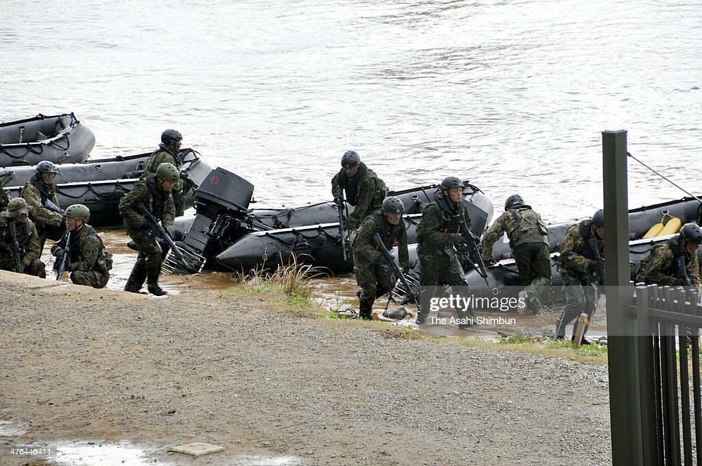Japan Ground Self-Defense Force (JGSDF) members take part in a landing exercise at JGSDF Camp Ainoura on March 2, 2014 in Sasebo, Nagasaki, Japan. The exercise is operated assuming to regain the isolated islands.