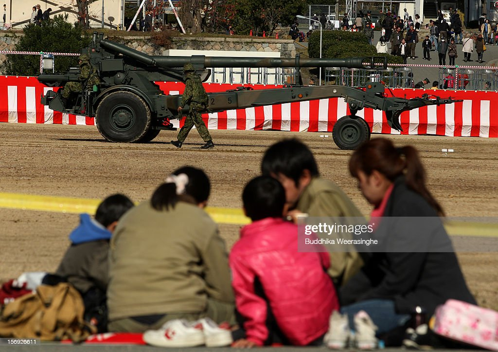 A Japan Ground Self-Defense Force (JGSDF) officer drives a Towed FH 70 artillery gun as people look on during the military demonstration on November 25, 2012 in Himeji, Japan. The military exhibition and demonstration marks the 61-year anniversary of the Japan Ground Self-Defense Force based in Himeji.