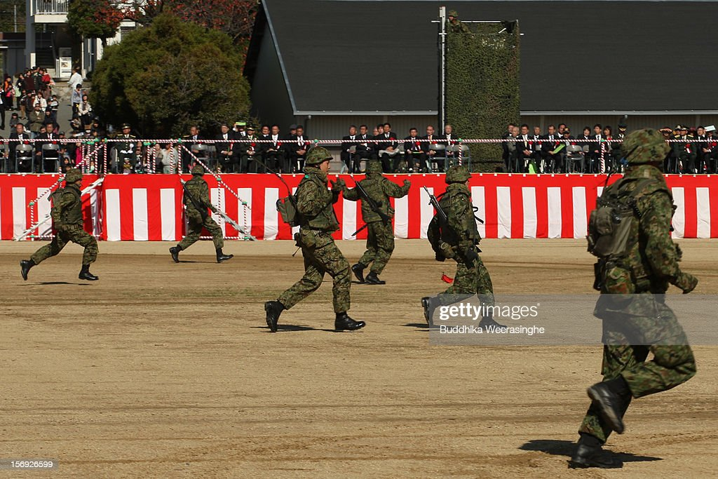 Japan Ground Self-Defense Force (JGSDF) officers take a part military demonstration on November 25, 2012 in Himeji, Japan. The military exhibition and demonstration marks the 61-year anniversary of the Japan Ground Self-Defense Force based in Himeji.