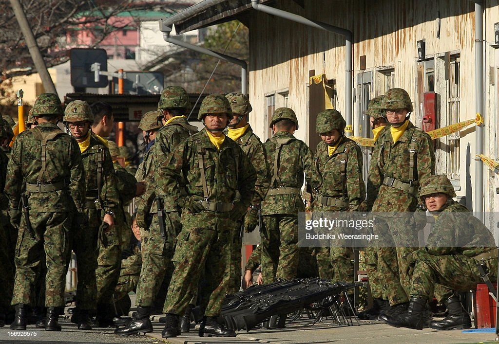 Japan Ground Self-Defense Force (JGSDF) officers wait to participate in a military demonstration on November 25, 2012 in Himeji, Japan. The military exhibition and demonstration marks the 61-year anniversary of the Japan Ground Self-Defense Force based in Himeji.