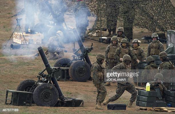 Japan Ground SelfDefense Force troops participate with US Marine Corps of the Expeditionary Fire Support System firing 120mm mortar systems during...