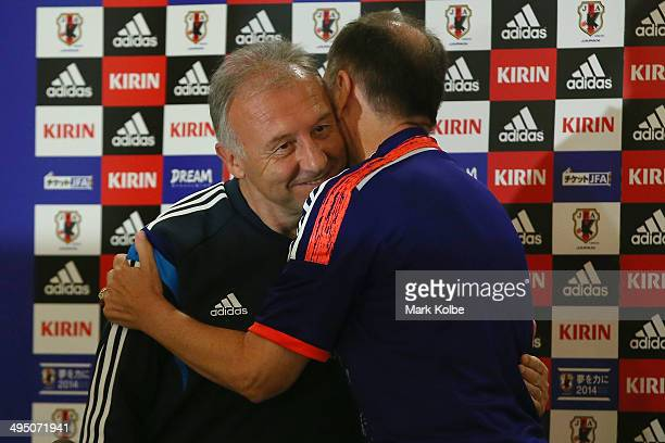 Japan head coach Alberto Zaccheroni embraces with Mayor of Clearwater George Cretekos after Cretekos was presented with a Japanese team shirt during...