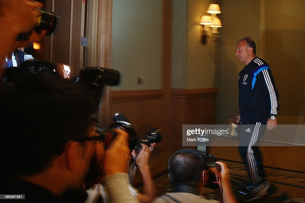 Japan head coach Alberto Zaccheroni leaves the room after a press conference at the Hyatt Regency Clearwater Beach Resort and Spa on June 1, 2014 in Clearwater, Florida.