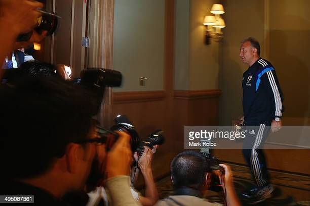 Japan head coach Alberto Zaccheroni leaves the room after a press conference at the Hyatt Regency Clearwater Beach Resort and Spa on June 1 2014 in...