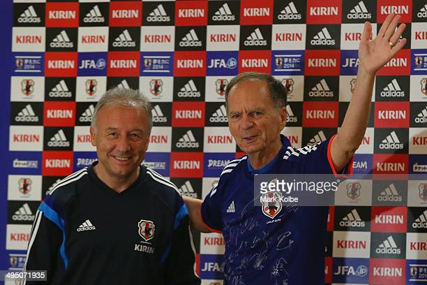 Japan head coach Alberto Zaccheroni poses with Mayor of Clearwater George Cretekos after Cretekos was presented with a Japanese team shirt during a...