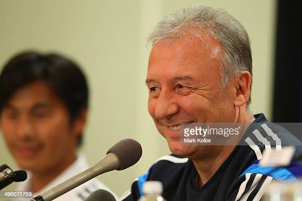 Japan head coach Alberto Zaccheroni smiles as he listens to questions from the media during a press conference at the Hyatt Regency Clearwater Beach...