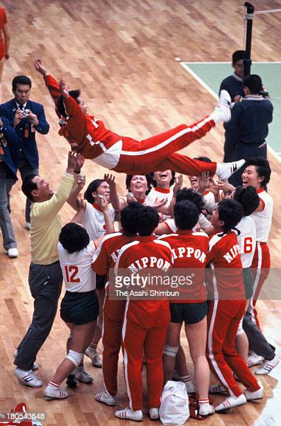 Japan head coach Hirobumi Daimatsu is thrown into the air after winning the gold medal of the Women's Volleyball during the Tokyo Olympics at...