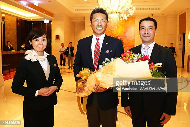 Japan head coach Hiroki Kokubo poses for photographs with staffs on arrival at a hotel on November 9 2015 in Taipei Taiwan