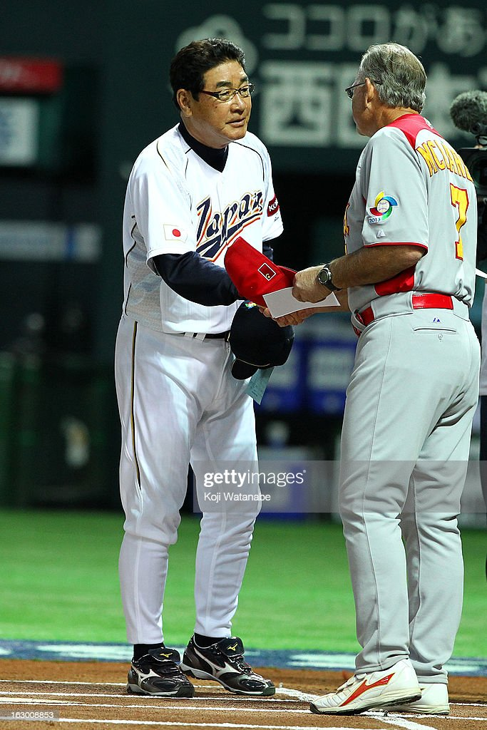Japan Head Coach Koji Yamamoto #88 and China Head Coach John McLaren sakes hand during the World Baseball Classic First Round Group A game between Japan and China at Fukuoka Yahoo! Japan Dome on March 3, 2013 in Fukuoka, Japan.