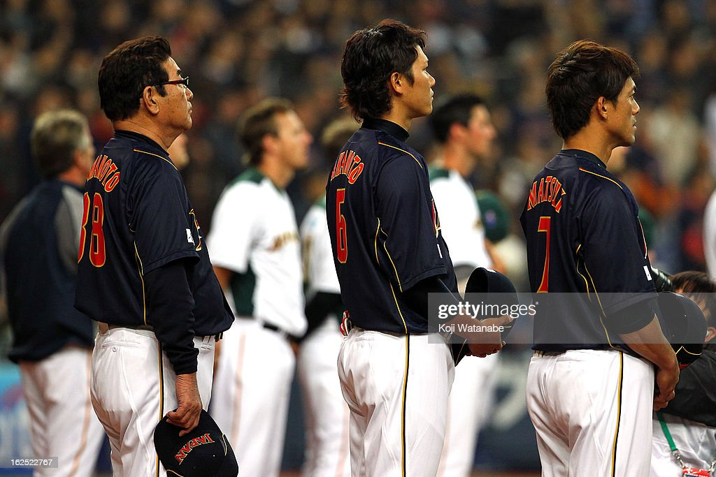 Japan Head Coach Koji Yamamoto #88 and Infielder Hayato Sakamoto #6 and Infielder Kazuo Matsui#7 of Japan line up for national anthem and the international friendly game between Australia and Japan at Kyocera Dome Osaka on February 24, 2013 in Osaka, Japan.