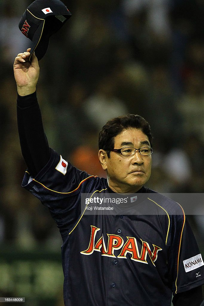 Japan Head Coach Koji Yamamoto #88 celerates after winnings during the World Baseball Classic Second Round Pool 1 game between Japan and the Netherlands at Tokyo Dome on March 10, 2013 in Tokyo, Japan.