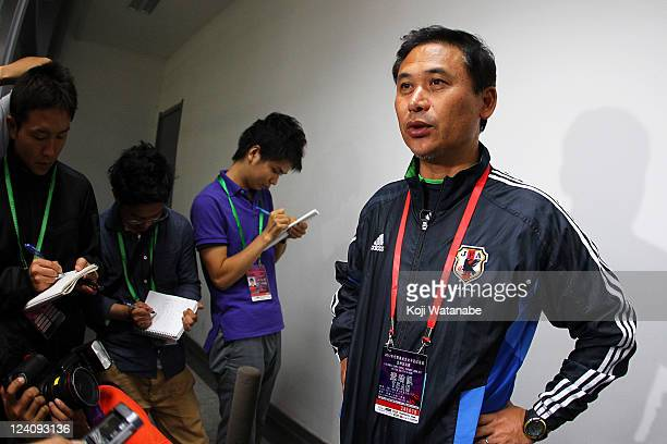 Japan head coach Norio Sasaki attends the press interview after securing the olympic berth at Jinan Olympic Sports Centre on September 8 2011 in...