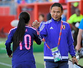 Japan head coach Norio Sasaki high fives with Homare Sawa after their 10 win in the FIFA Women's World Cup 2015 Group C match between Ecuador and...