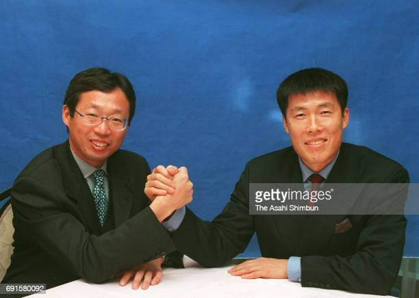 Japan head coach Takeshi Okada and South Korean head coach Cha Bumkun shake hands during their meeting on December 21 1997 in Tokyo Japan