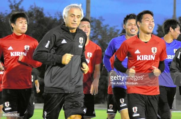 Japan head coach Vahid Halilhodzic and his players warm up during a training session on October 1 2017 in Toyota Aichi Japan