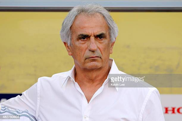 Japan head coach Vahid Halilhodzic stands for the Japan's national antem before the match against DRR Korea during EAFF East Asian Cup 2015 final...