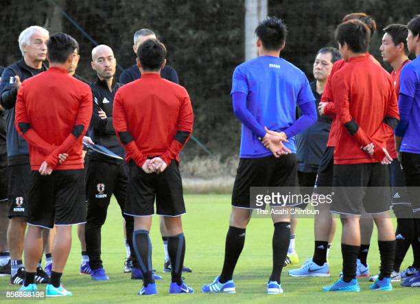 Japan head coach Vahid Halilhodzic talks to his players during a training session on October 1 2017 in Toyota Aichi Japan