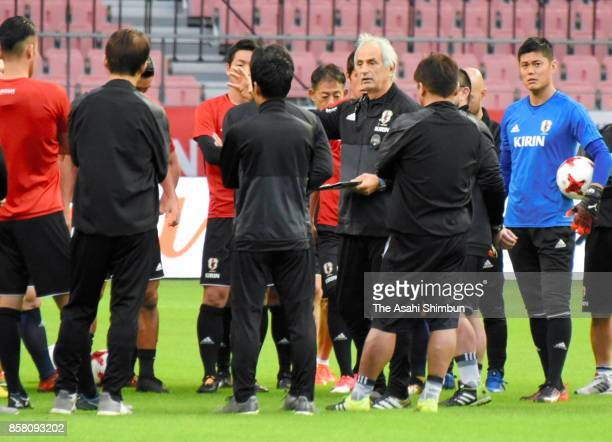Japan head coach Vahid Halilhodzic talks to players during a training session at Toyota Stadium on October 6 2017 in Toyota Aichi Japan