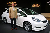 TOKYO Japan Honda Motor Co President Takanobu Ito stands beside the Fit Shuttle the automaker's new compact wagon model at the company's headquarters...