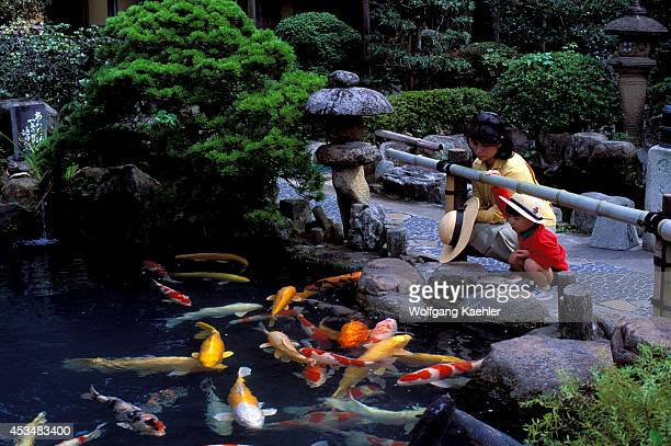 Japan Honshu Ismatsue Restaurant With Japanese Garden Mother With Boy Watching Carp