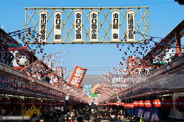 Japan, Honshu, Tokyo, Asakusa, New Year's decorations over Nakimese shopping street to Senso-ji temple