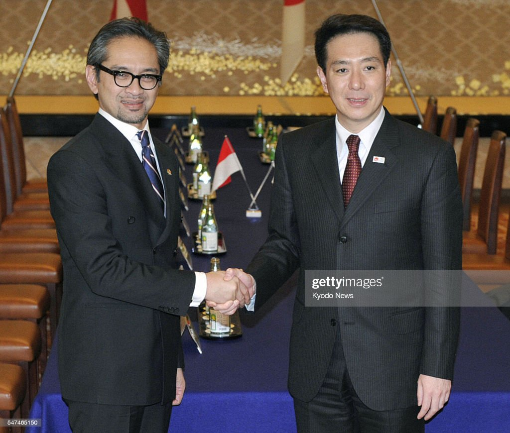 TOKYO Japan Indonesian Foreign Minister Marty Natalegawa shakes hands with Japanese Foreign Minister Seiji Maehara ahead of their talks in Tokyo on...