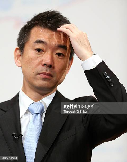 Japan Innovation Party co leader Toru Hashimoto looks on at the party's election campaign headquarters on December 14 2014 in Osaka Japan Ruling...