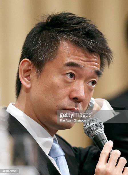 Japan Innovation Party co leader Toru Hashimoto speaks during a press conference at the party's election campaign headquarters on December 14 2014 in...