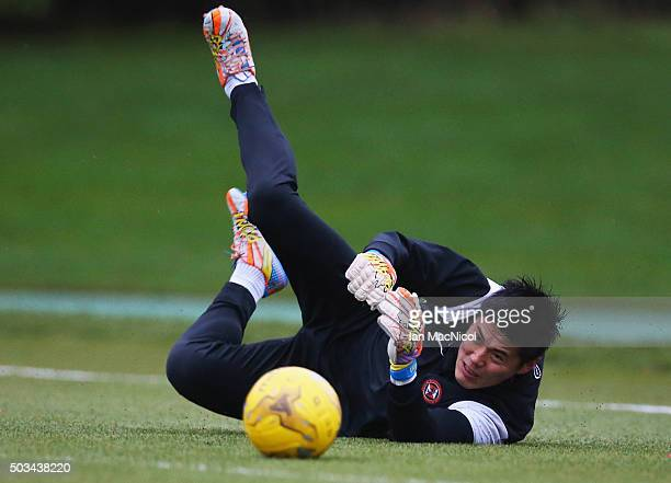 Japan international goalkeeper Eiji Kawashima of Dundee United dives for the ball during a Dundee United training session at St Andrews Sports Centre...