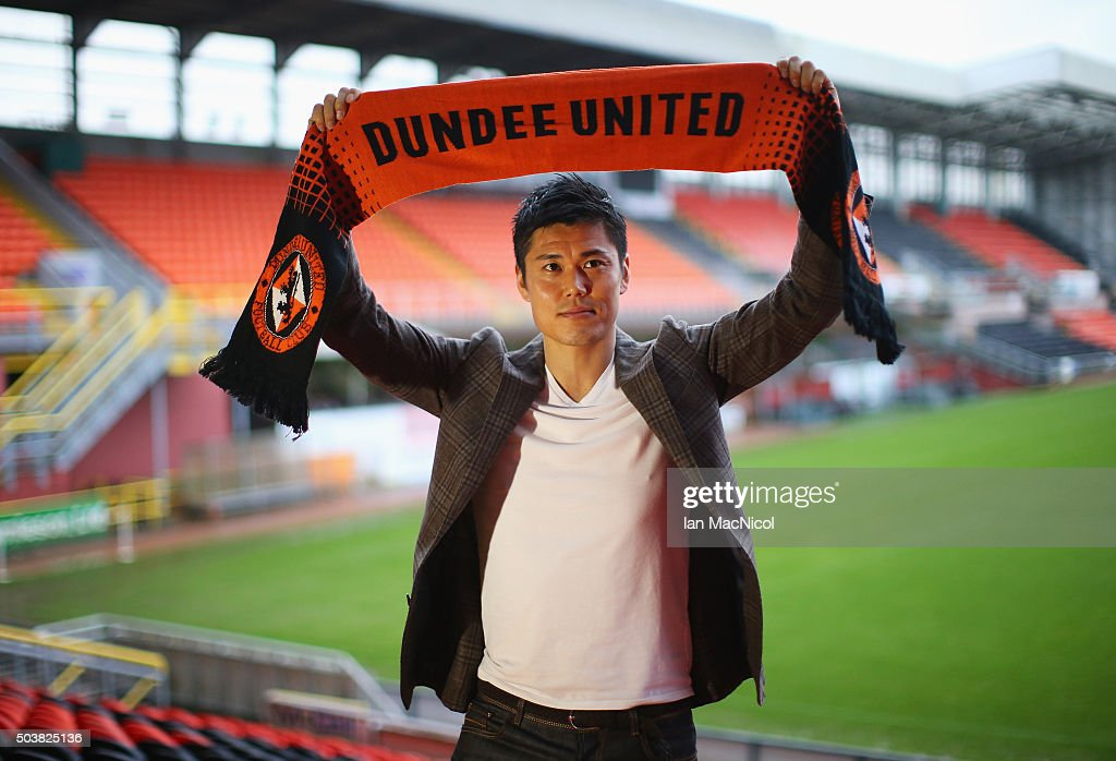 Japan international goalkeeper <a gi-track='captionPersonalityLinkClicked' href=/galleries/search?phrase=Eiji+Kawashima&family=editorial&specificpeople=3117136 ng-click='$event.stopPropagation()'>Eiji Kawashima</a> of Dundee United poses with a scarf after a press conference at Tannadice Stadium on January 7, 2016 in Dundee, Scotland.