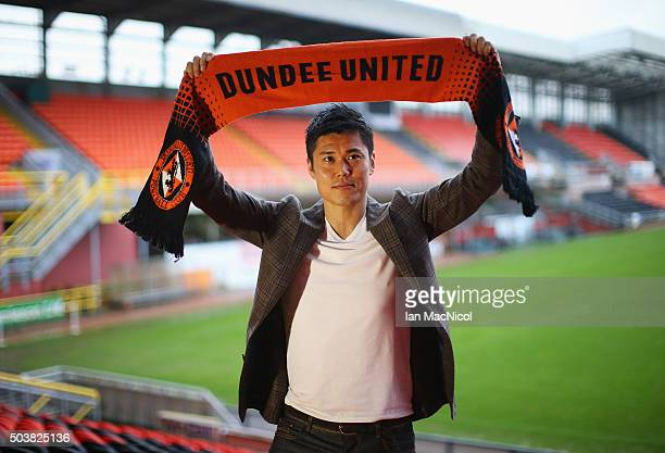 Japan international goalkeeper Eiji Kawashima of Dundee United poses with a scarf after a press conference at Tannadice Stadium on January 7 2016 in...