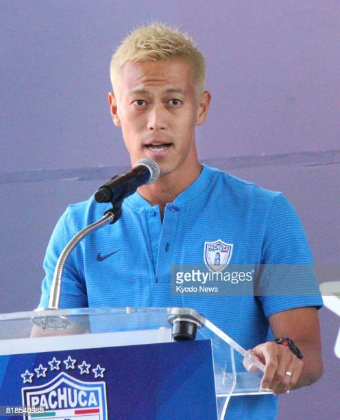Japan international midfielder Keisuke Honda speaks at a press conference for new signees of Mexican club Pachuca in Pachuca on July 18 2017 Honda...