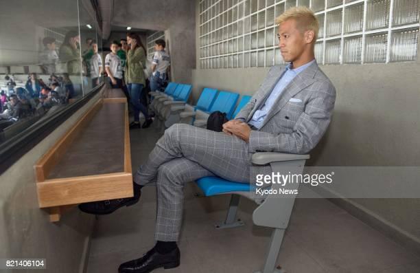 Japan international midfielder Keisuke Honda watches from VIP box seats as Pachuca lose 10 away at Pumas UNAM in the Mexican League Apertura...