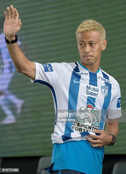 Japan international midfielder Keisuke Honda waves to fans during a press conference to unveil new players of Mexican club Pachuca in Pachuca on July...