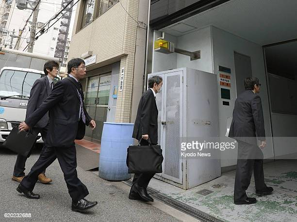 OSAKA Japan Investigators from the Osaka Labor Bureau of the Ministry of Health Labor and Welfare enter printing firm SanyoCYP Co in Osaka on April 2...