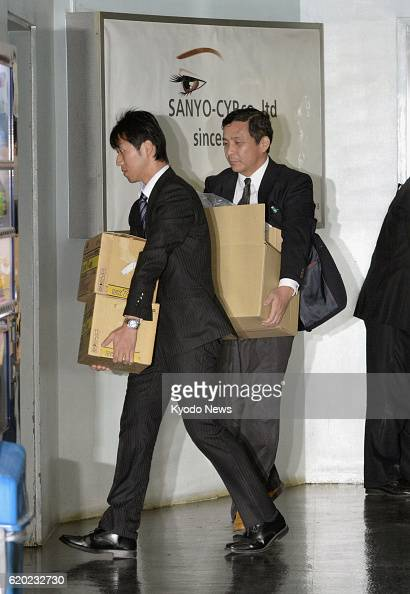 OSAKA Japan Investigators from the Osaka Labor Bureau of the Ministry of Health Labor and Welfare leave printing firm SanyoCYP Co in Osaka on April 2...