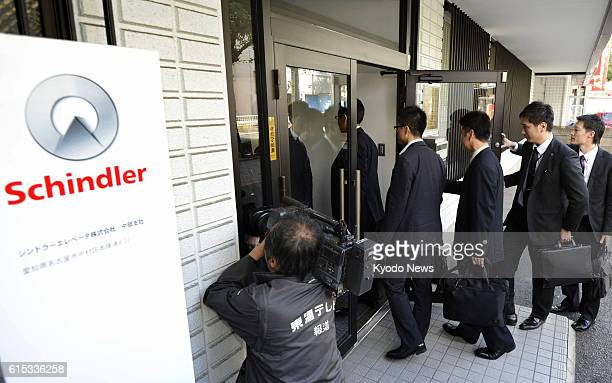 NAGOYA Japan Ishikawa prefectural police officers enter an office of Swiss firm Schindler in Nagoya on Nov 1 after a 63yearold parttime hotel worker...