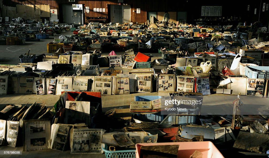NATORI Japan Items including family pictures school bags and toys retrieved from debris after the March 11 quake and tsunami are lined up at a...