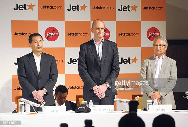 TOKYO Japan Japan Airlines Co President Masaru Onishi Jetstar Group Chief Executive Officer Bruce Buchanan and Hideshi Takeuchi vice president and...