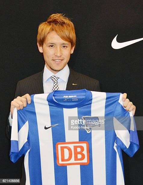 TOKYO Japan Japan midfielder Hajime Hosogai holds a jersey of promoted Bundesliga outfit Hertha Berlin in Tokyo on May 21 as he announced his full...