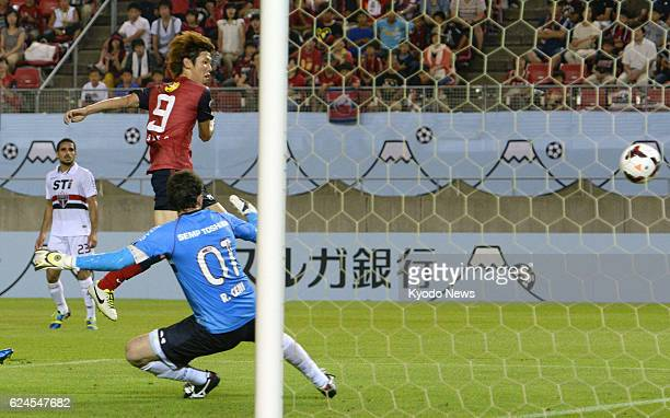 KASHIMA Japan Japan striker Yuya Osako of Kashima Antlers scores his second goal past Sao Paulo of Brazil goalkeeper Rogerio Ceni during the first...