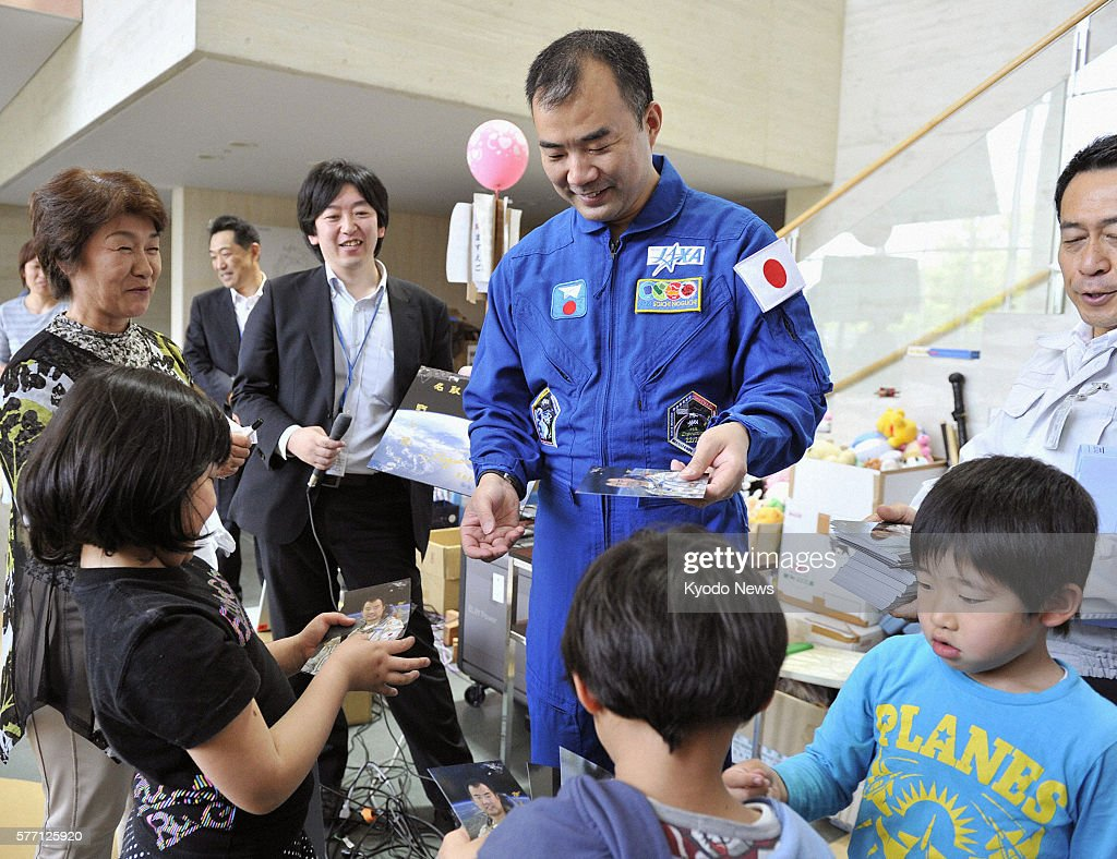 NATORI Japan Japanese astronaut Soichi Noguchi visits an evacuation shelter in Natori Miyagi Prefecture on May 14 to encourage children affected by...