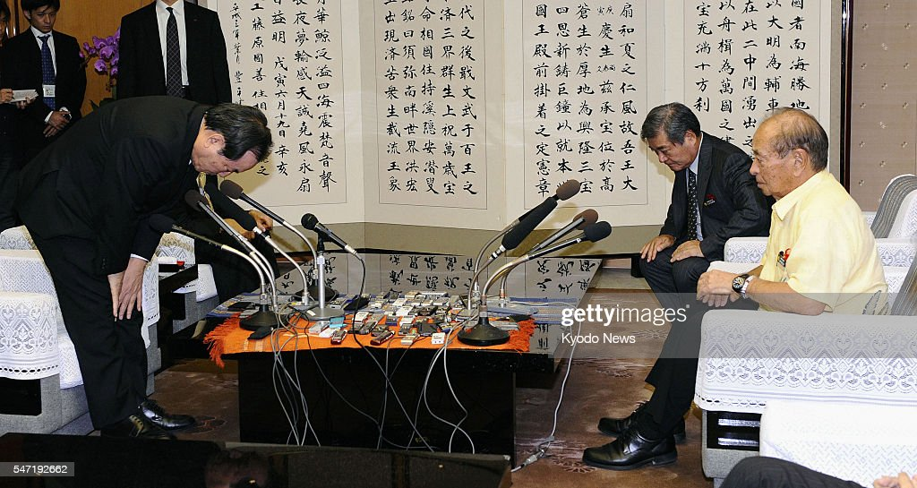 NAHA Japan Japanese Defense Minister Yasuo Ichikawa bows deeply to Okinawa Gov Hirokazu Nakaima in a gesture of apology over an indiscreet comment...