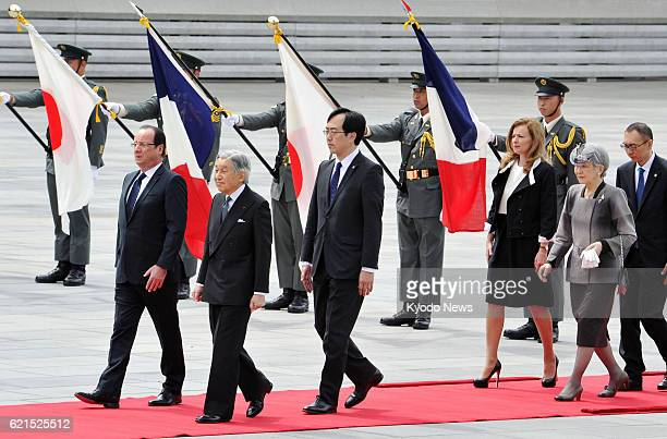 TOKYO Japan Japanese Emperor Akihito and Empress Michiko escort French President Francois Hollande and his partner Valerie Trierweiler during a...