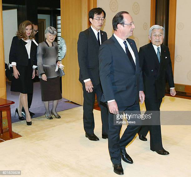 TOKYO Japan Japanese Emperor Akihito and Empress Michiko escort French President Francois Hollande and his partner Valerie Trierweiler for their...