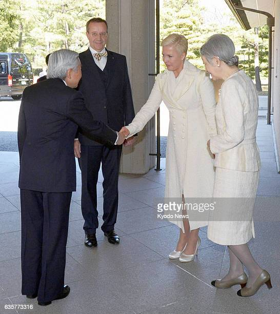 TOKYO Japan Japanese Emperor Akihito and Empress Michiko see Estonian President Toomas Hendrik Ilves and his wife Evelin off after their meeting at...