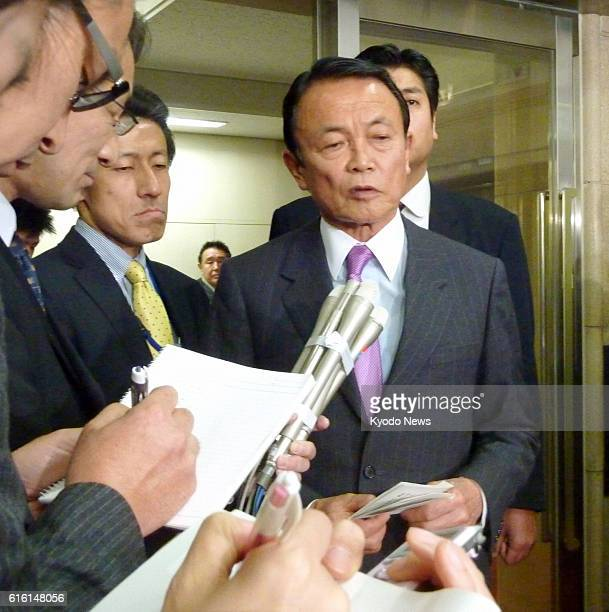 TOKYO Japan Japanese Finance Minister Taro Aso answers reporters' questions at the ministry in Tokyo on Dec 28 after holding a 30minute phone...