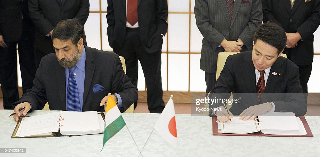 TOKYO Japan Japanese Foreign Minister Seiji Maehara and Indian Commerce and Industry Minister Anand Sharma sign a bilateral free trade agreement in...