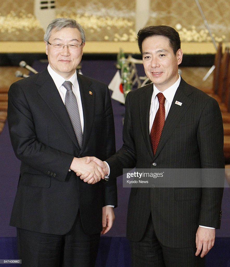 TOKYO Japan Japanese Foreign Minister Seiji Maehara and South Korean Foreign Affairs and Trade Minister Kim Sung Hwan shake hands in Tokyo on Feb 16...