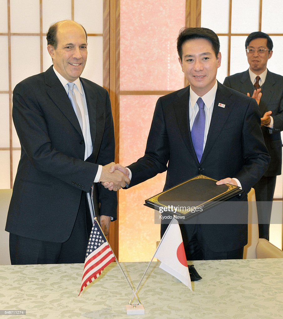 TOKYO Japan Japanese Foreign Minister Seiji Maehara and US Ambassador to Japan John Roos shake hands at the Foreign Ministry in Tokyo on Jan 21 after...